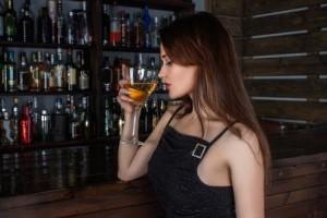Woman battling drunkorexia