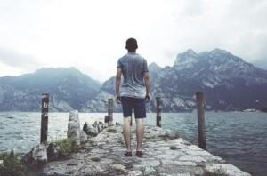 Man walking by lake