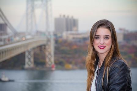woman with eating disorder standing near large bridge