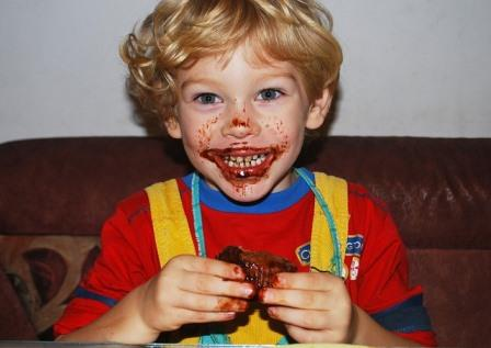 Child with bbq sauce all over his face