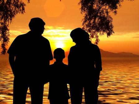 Family's silhoute at the beach