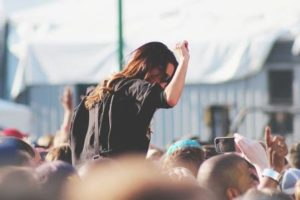 Woman enjoying herself at a music festival