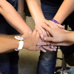 Treatment team with hands together