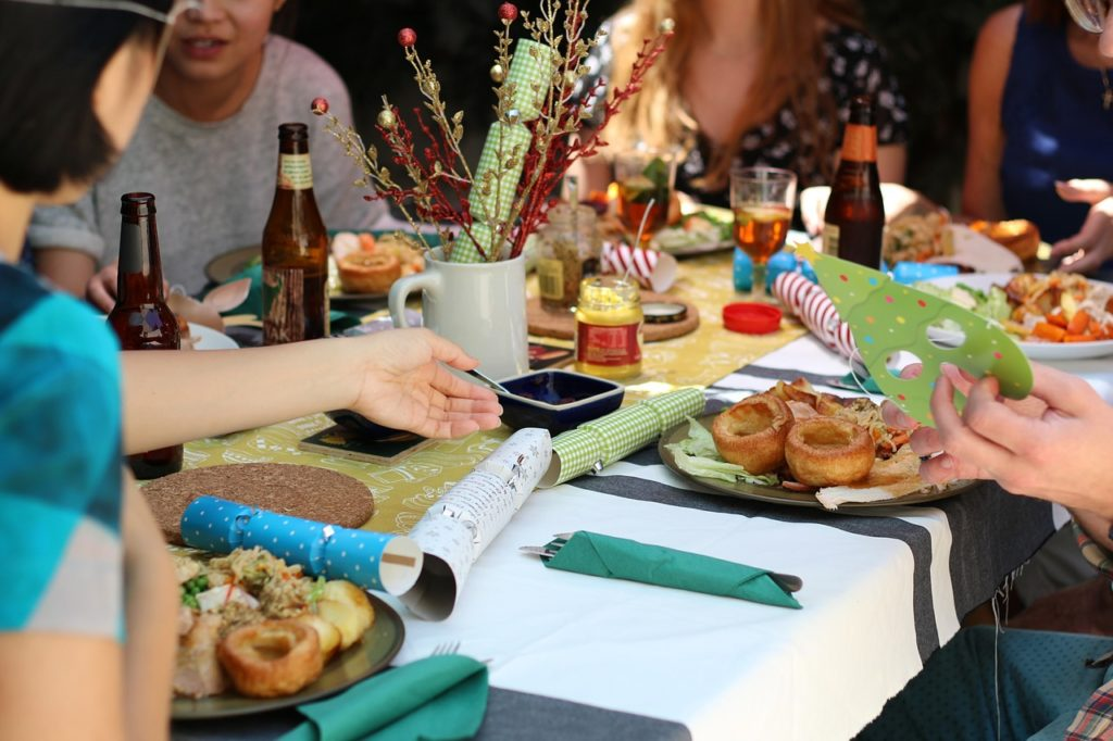 picture of dinner party and binge eating disorder