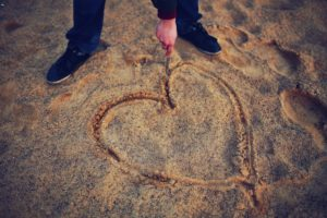 heart etched in the sand symbolizing Body Positivity
