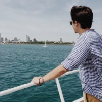 Man on a boat contemplating exposure-based therapy for eating disorders