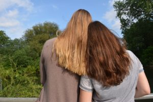 Girl supporting her friend in her contemplation stage of eating disorder recovery