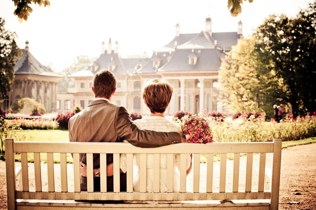Spouse sitting on bench