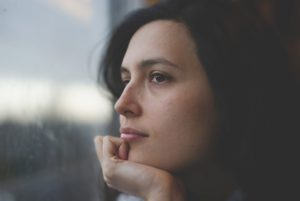 Woman thinking about perimenopause
