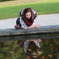 Woman reflection pond