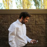 Man researching exposure-based therapy on his smart phone.