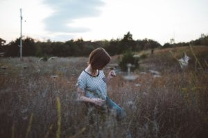 Woman with eating disorder in field
