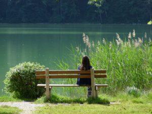 Girl on bench considering ED treatment