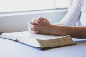 Woman praying for recovery from eating disorder