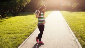 Pregnant woman on path