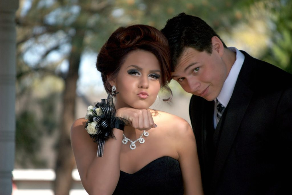 Prom couple posing