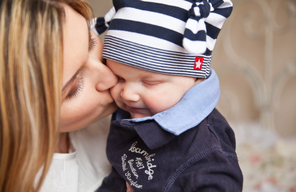 Woman with Postpartum Depression kissing her son