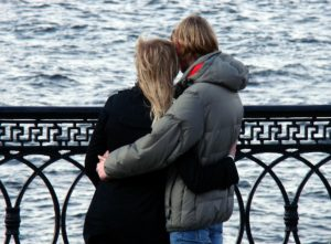 Couple on the boardwalk dealing with Anorexia and Relationship Issues