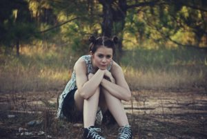 College aged girl struggling with binge eating disorder