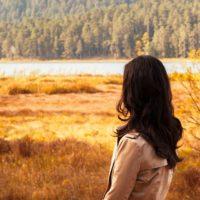 Woman looking at a lake