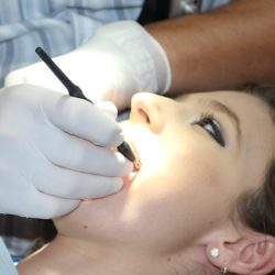 Woman Receiving A Dental Cleaning