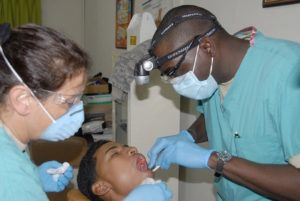 Young Man Receiving A Dental Cleaning