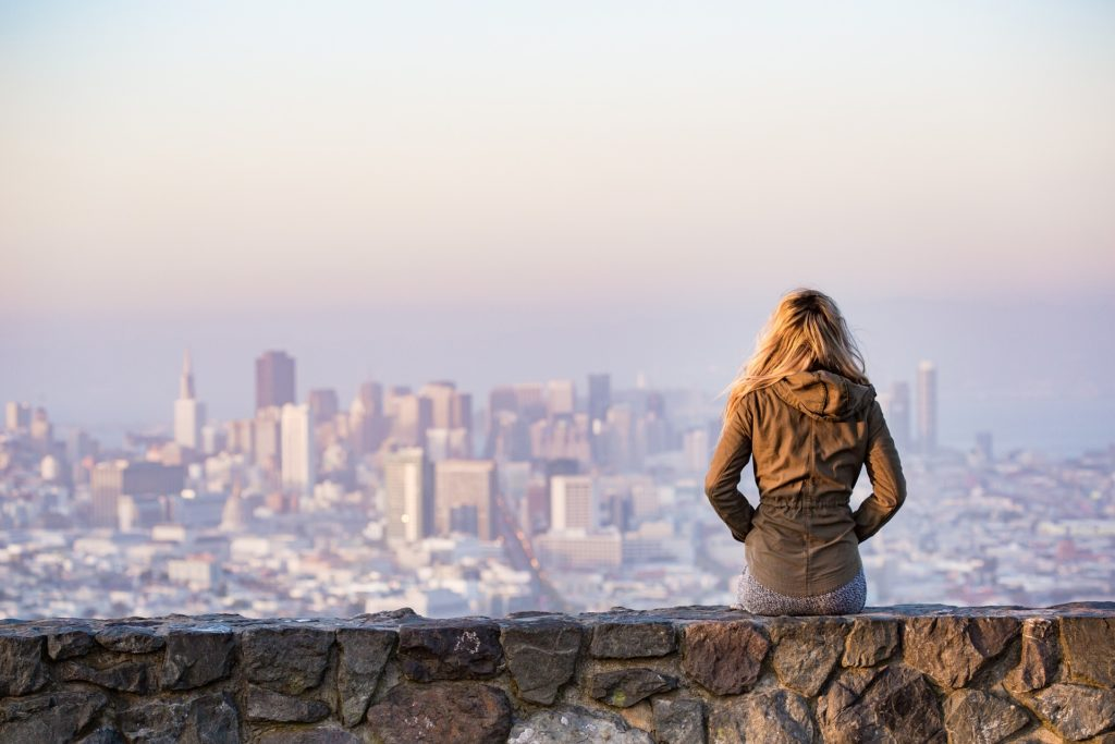 Woman looking over city