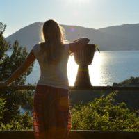 Girl looking at a lake