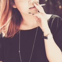 Woman using smoking as appetite suppressant