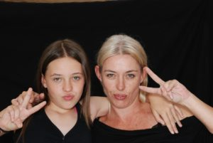Mother And Daughter Flashing The Peace Sign Durring Family Therapy For Eating Disorders