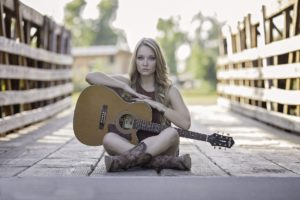 Teen with guitar and eating disorder