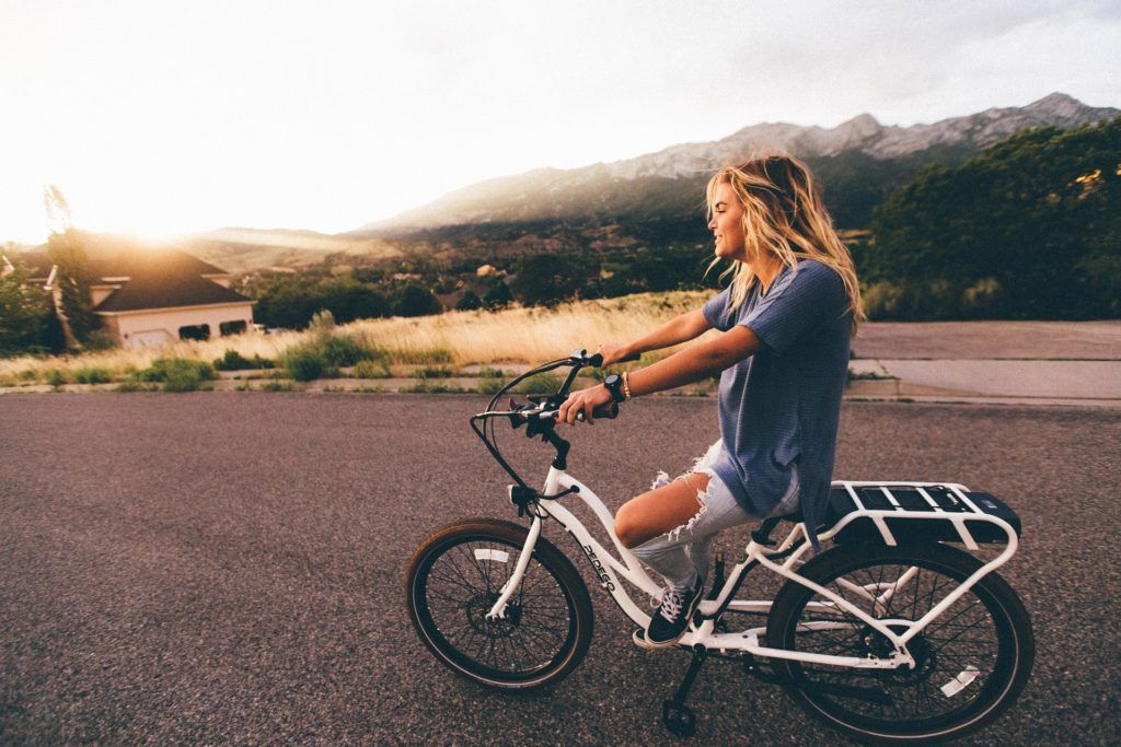 Teen girl on bicycle