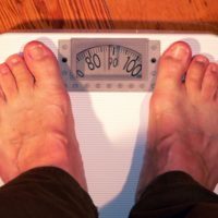 Man weighing in on the scales