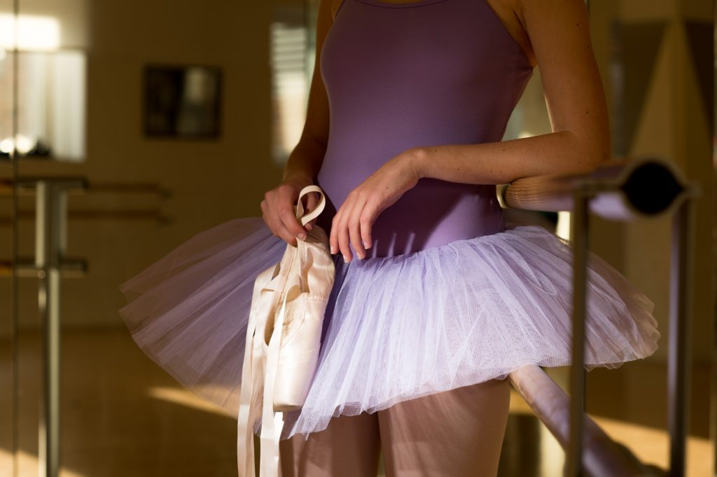 Woman with ballet slippers struggling with anorexia