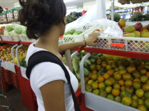 Woman shopping for fruit
