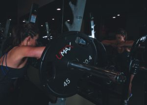 Woman lifting weights and exercising