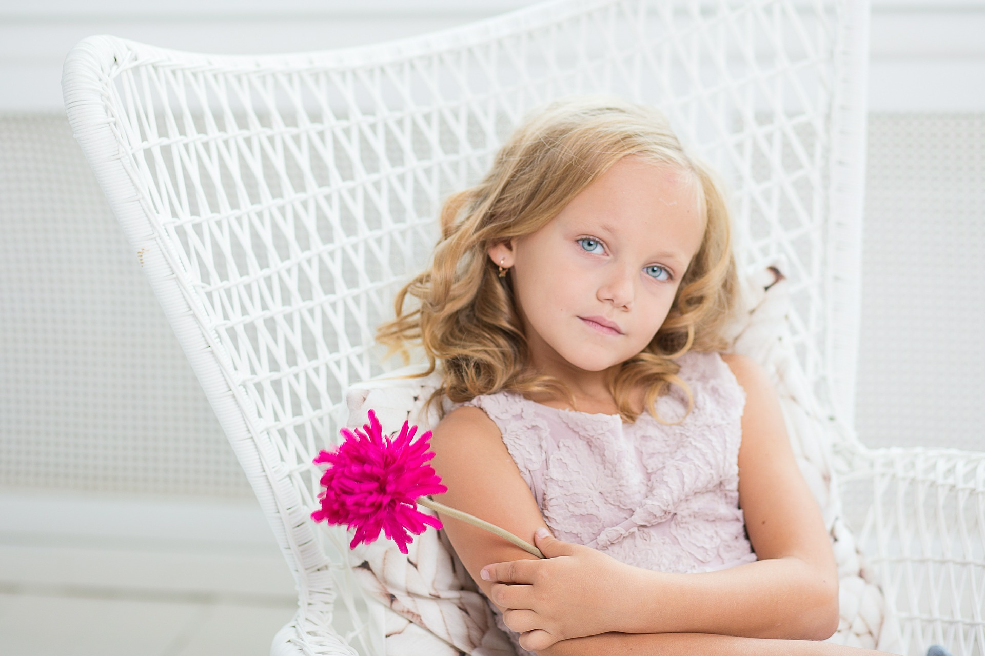 Young Girl holding a flower