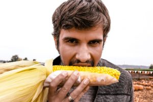 Man with orthorexia eating corn