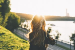 Woman looking at lake and giving herself Self-Compassion