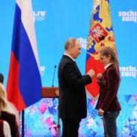 Yulia Lipnitskaia and Vladimir Putin