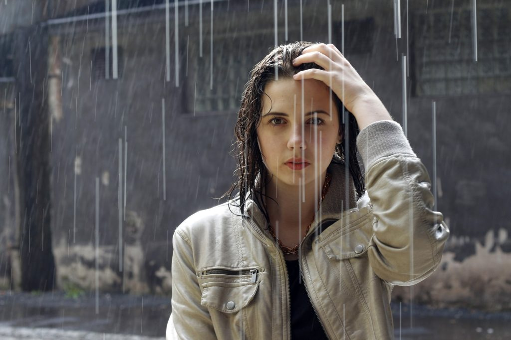 Woman with Anorexia in the rain