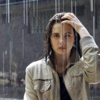 Woman with Diabulimia in the rain