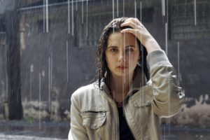 Woman with Binge eating disorder in the rain