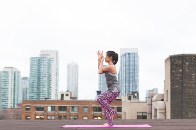 Woman doing yoga on the roof