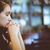 Girl praying for eating disorder recovery