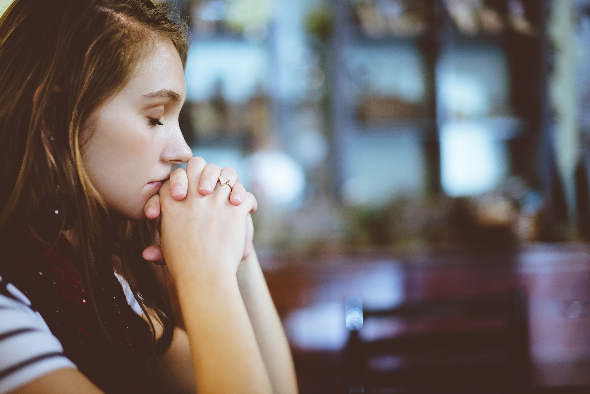 Girl praying for eating disorder recovery