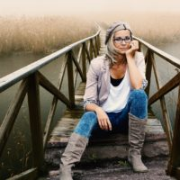Woman sitting on a bridge struggling with disordered eating