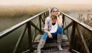 Woman sitting on a bridge struggling with bulimia