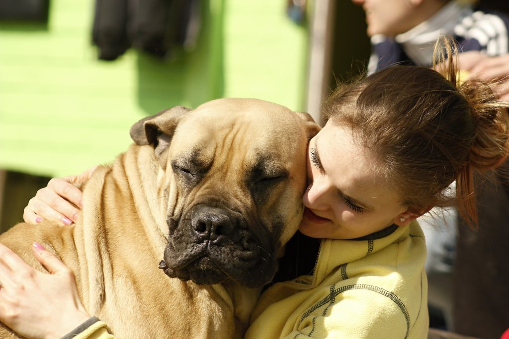 Girl hugging her dog using pet therapy in eating disorder treatment