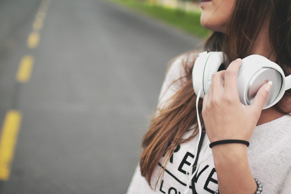 Adolescent girl listening to headphones